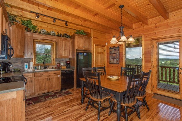Dining table for 6 in the kitchen at Mountain Adventure, a 2 bedroom cabin rental located in Pigeon Forge