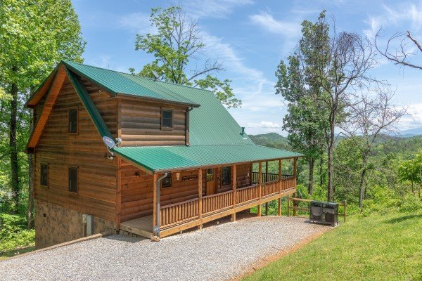 Driveway and cabin exterior at Mountain Adventure, a 2 bedroom cabin rental located in Pigeon Forge