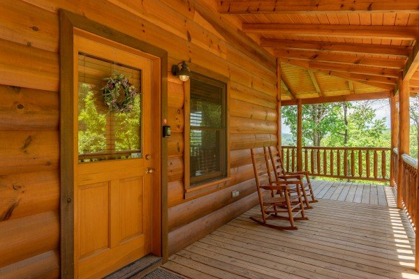 Front porch with rocking chairs at Mountain Adventure, a 2 bedroom cabin rental located in Pigeon Forge