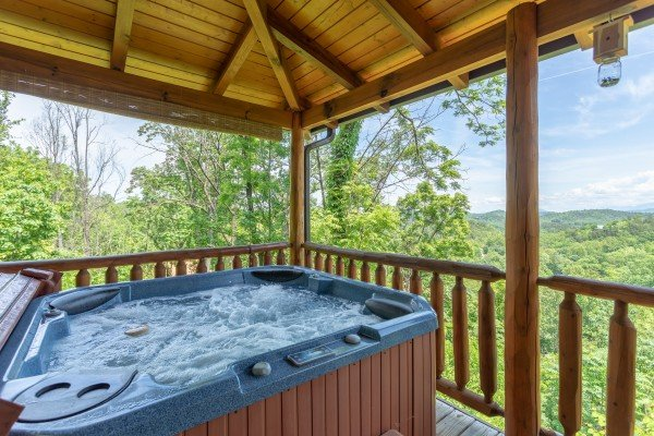 View from the hot tub on the covered porch at Mountain Adventure, a 2 bedroom cabin rental located in Pigeon Forge
