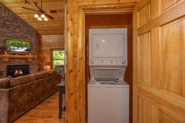 Stacked washer and dryer in a closet at Mountain Adventure, a 2 bedroom cabin rental located in Pigeon Forge