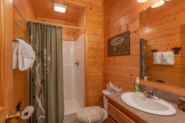 Bathroom with a walk in shower at Mountain Adventure, a 2 bedroom cabin rental located in Pigeon Forge