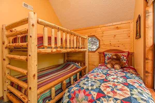 Sleeping for three in the upstairs bedroom at Lazy Dayz Lodge, a 4 bedroom cabin rental located in Pigeon Forge