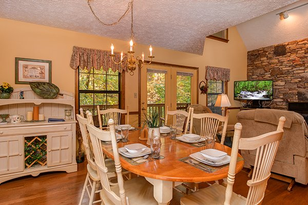 Dining space for six on the open concept main floor at Lazy Dayz Lodge, a 4 bedroom cabin rental located in Pigeon Forge