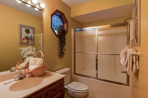 Bathroom with a tub and shower at Lazy Dayz Lodge, a 4 bedroom cabin rental located in Pigeon Forge