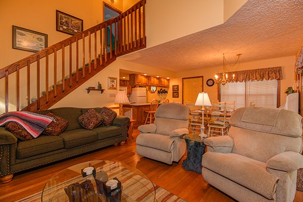 Living room with a sofa and two recliners at Lazy Dayz Lodge, a 4 bedroom cabin rental located in Pigeon Forge