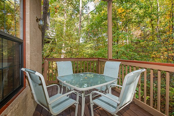 Dining table for four at Lazy Dayz Lodge, a 4 bedroom cabin rental located in Pigeon Forge