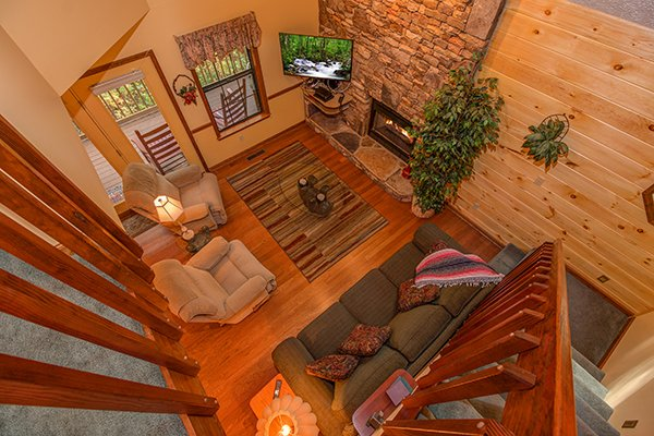 Looking down into the living room from the upper floor at Lazy Dayz Lodge, a 4 bedroom cabin rental located in Pigeon Forge