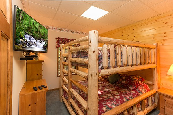 Room with queen bunk bed and a TV at Lazy Dayz Lodge, a 4 bedroom cabin rental located in Pigeon Forge