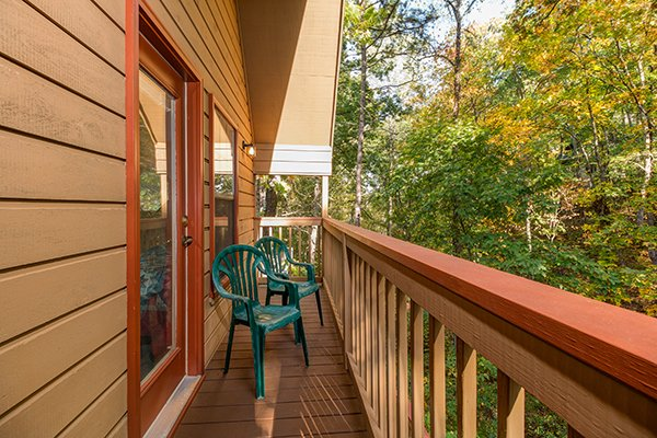 Upper deck with seating for two at Lazy Dayz Lodge, a 4 bedroom cabin rental located in Pigeon Forge