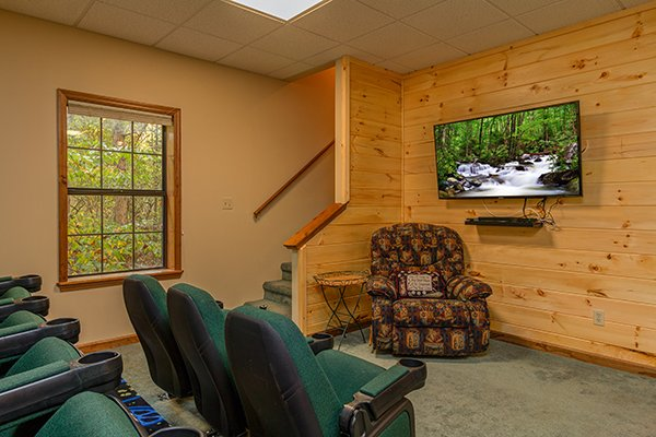 Theater room with real movie theater seating at Lazy Dayz Lodge, a 4 bedroom cabin rental located in Pigeon Forge