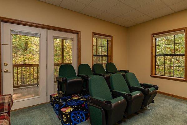 Stadium seating in the theater room at Lazy Dayz Lodge, a 4 bedroom cabin rental located in Pigeon Forge
