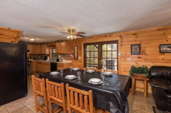 Dining space for six at Pine Splendor, a 5 bedroom cabin rental located in Pigeon Forge