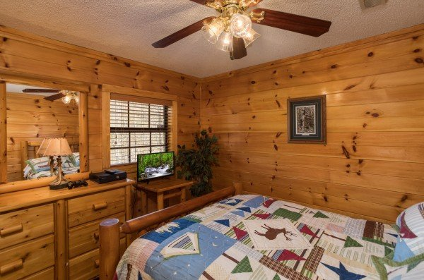 Bedroom with a dresser and TV at Pine Splendor, a 5 bedroom cabin rental located in Pigeon Forge