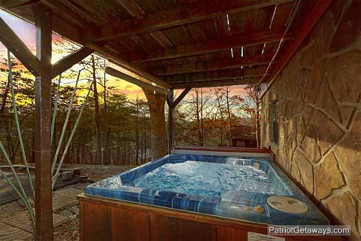 Lower level deck with hot tub at Pine Splendor, a 5 bedroom cabin rental located in Pigeon Forge