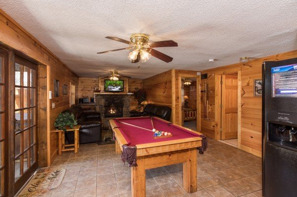 Pool table on the main floor at Pine Splendor, a 5 bedroom cabin rental located in Pigeon Forge