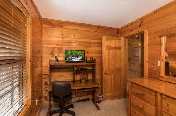 Desk with TV in the queen bedroom on the second floor at Pine Splendor, a 5 bedroom cabin rental located in Pigeon Forge