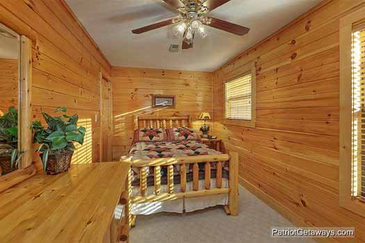 Second floor bedroom with full sized bed at Pine Splendor, a 5 bedroom cabin rental located in Pigeon Forge