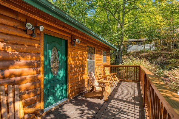 Deck with Adirondack chairs at Pine Splendor, a 5 bedroom cabin rental located in Pigeon Forge