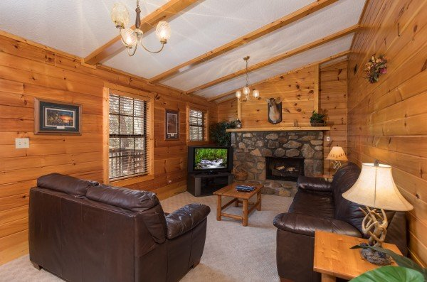 Living room on the second floor at Pine Splendor, a 5 bedroom cabin rental located in Pigeon Forge