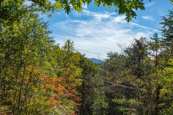Mountain peak above the trees at Pine Splendor, a 5 bedroom cabin rental located in Pigeon Forge