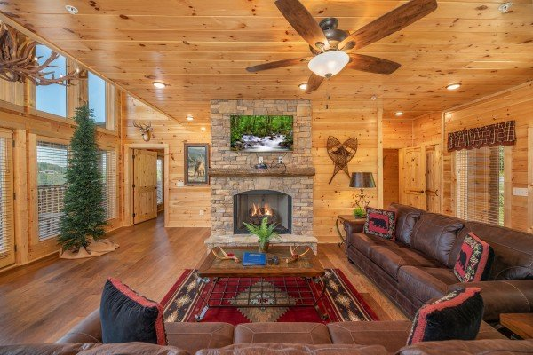 Living room fireplace & TV at Elk Horn Lodge, a 5 bedroom cabin rental located in Gatlinburg