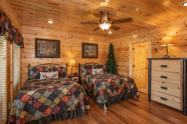Bedroom with two full sized beds at Elk Horn Lodge, a 5 bedroom cabin rental located in Gatlinburg