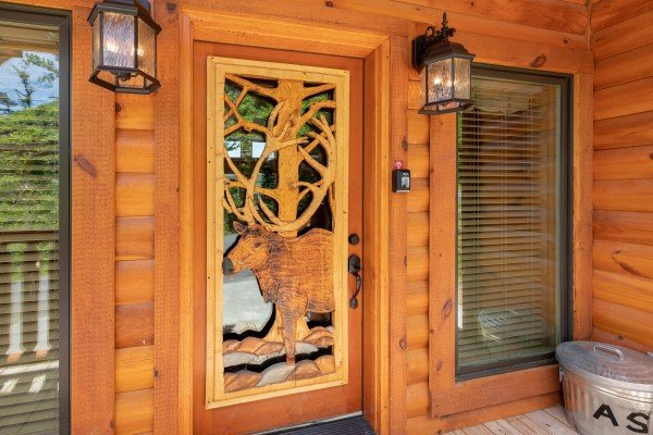 Elk carving in the front door at Elk Horn Lodge, a 5 bedroom cabin rental located in Gatlinburg