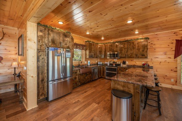Kitchen with stainless appliances and granite counters at Elk Horn Lodge, a 5 bedroom cabin rental located in Gatlinburg