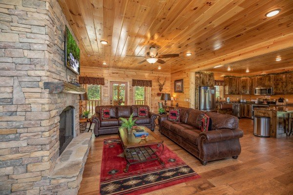 Seating in the living room at Elk Horn Lodge, a 5 bedroom cabin rental located in Gatlinburg