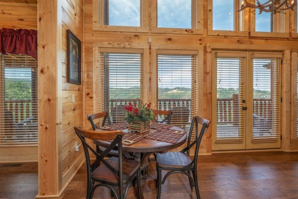Dining table for four at Elk Horn Lodge, a 5 bedroom cabin rental located in Gatlinburg