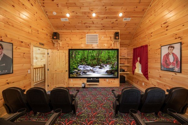 Theater room with stadium seating and large screen at Elk Horn Lodge, a 5 bedroom cabin rental located in Gatlinburg