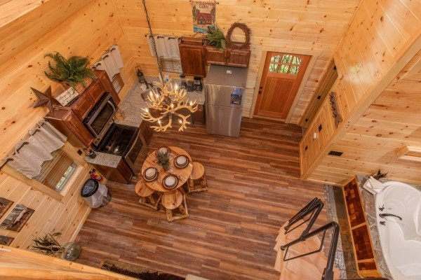 Looking down on the main floor at Smoky Mountain Treehouse, a 1 bedroom cabin rental located in Gatlinburg