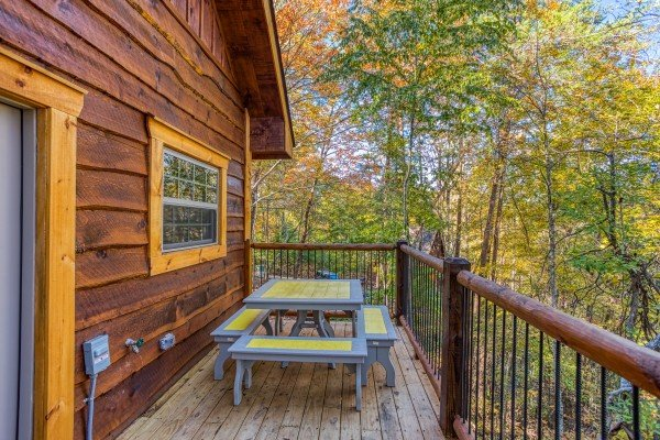 Deck dining for four at Smoky Mountain Treehouse, a 1 bedroom cabin rental located in Gatlinburg