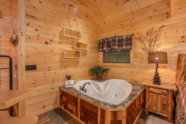 Heart shaped jacuzzi at Smoky Mountain Treehouse, a 1 bedroom cabin rental located in Gatlinburg