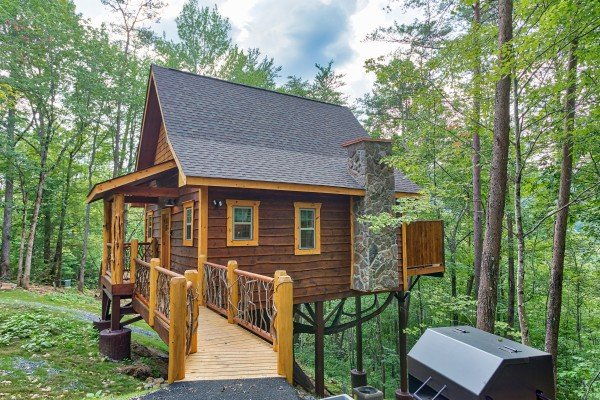 Bridge to the main cabin at Smoky Mountain Treehouse, a 1 bedroom cabin rental located in Gatlinburg