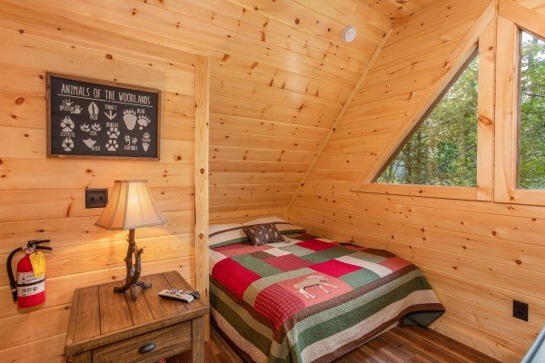 Queen bed in the loft at Smoky Mountain Treehouse, a 1 bedroom cabin rental located in Gatlinburg