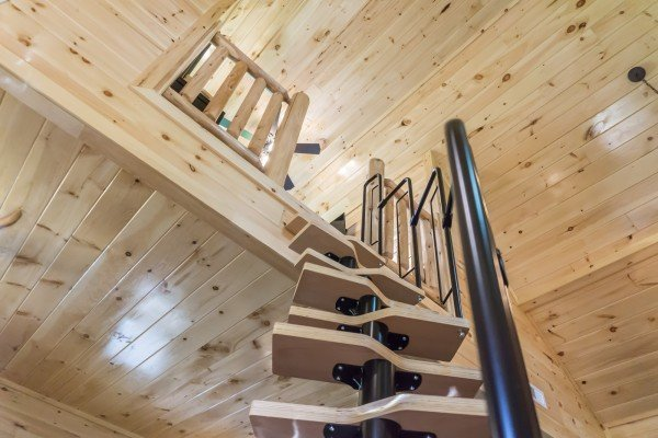 Staircase leading to the loft at Smoky Mountain Treehouse, a 1 bedroom cabin rental located in Gatlinburg