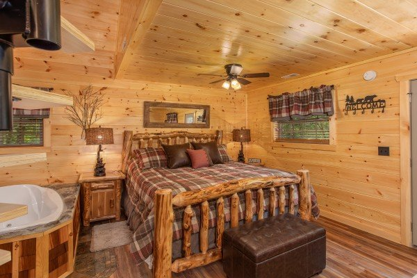 King log bed on the first floor at Smoky Mountain Treehouse, a 1 bedroom cabin rental located in Gatlinburg