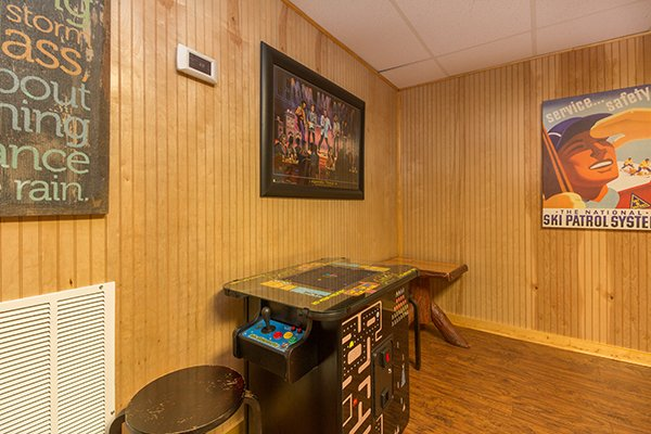Arcade game table at Up the Creek, a 4 bedroom cabin rental located in Gatlinburg