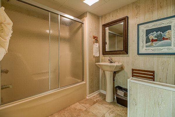Bathroom off the game room at Up the Creek, a 4 bedroom cabin rental located in Gatlinburg