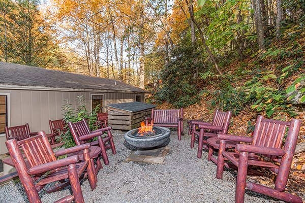 Fire pit with rocking chairs at Up the Creek, a 4 bedroom cabin rental located in Gatlinburg