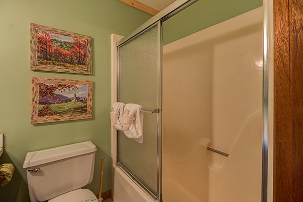 Bathroom with a tub and shower at Up the Creek, a 4 bedroom cabin rental located in Gatlinburg