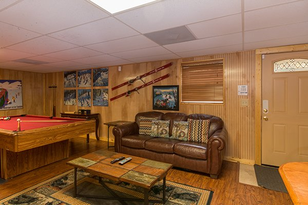 Sofa in the game room at Up the Creek, a 4 bedroom cabin rental located in Gatlinburg