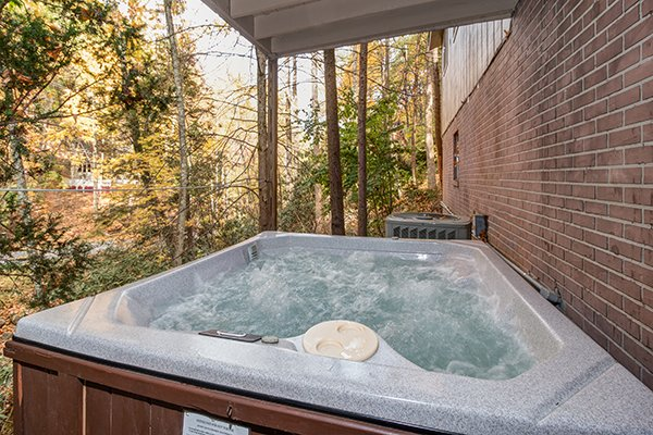 Hot tub on a covered deck at Up the Creek, a 4 bedroom cabin rental located in Gatlinburg
