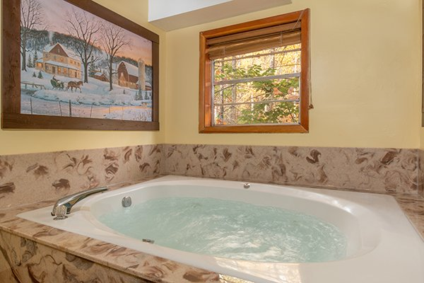 Jacuzzi downstairs at Up the Creek, a 4 bedroom cabin rental located in Gatlinburg