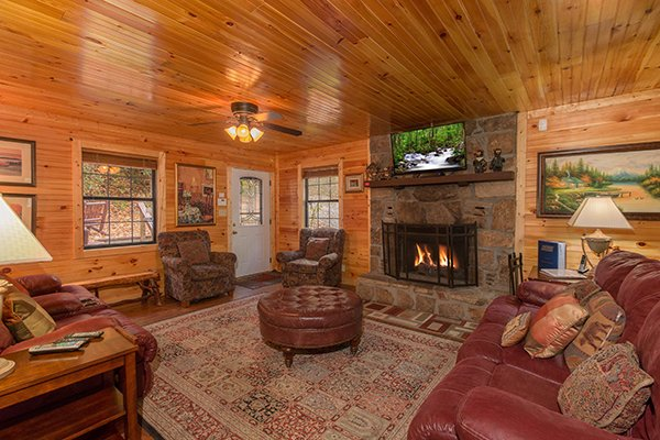 Living room with fireplace and TV at Up the Creek, a 4 bedroom cabin rental located in Gatlinburg