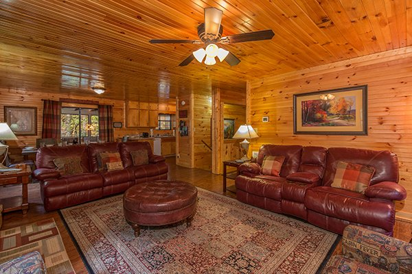 Two sofas and an ottoman in the living room at Up the Creek, a 4 bedroom cabin rental located in Gatlinburg
