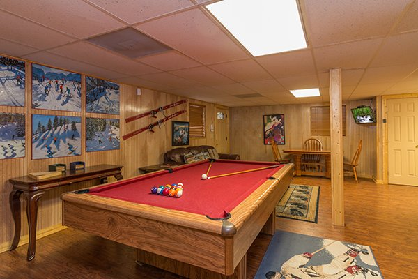 Pool table in the game room at Up the Creek, a 4 bedroom cabin rental located in Gatlinburg