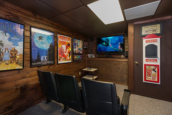 Theater room with movie seats at Up the Creek, a 4 bedroom cabin rental located in Gatlinburg